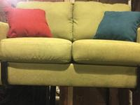 Super cute, soft, light green couch. It's very artsy.
