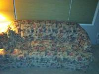 Couch and Love seat with a flower patter