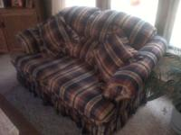 Brown/tan/blue plaid country style couch and love seat.