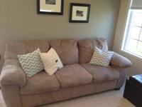 Tan microfiber couch and loveseat from JCPenny. Good