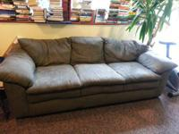 Couch and loveseat really good condition split with the