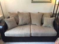 Comfortable couch and loveseat combo. The beige fabric