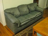 Very comfortable, clean green sofa upholstered in