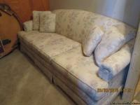 I am selling this beautiful couch (approximately 7ft)