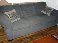 This is a good big couch in grey/olive. It's been made