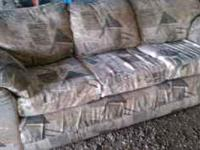 A matching couch and love seat in good condition from a