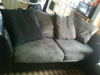 Black leather & gray suede couch and loveseat with