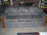 In GREAT condition matching couch and loveseat with oak