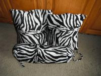 I have 3 matching black and white stripped bed or couch