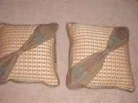 Nice looking couch pillows. Colors are brown, beige,