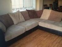 It's a Robert Michael designer sectional suede couch