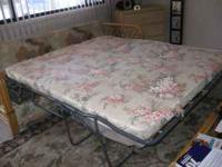 Floral, rattan couch with full pull out bed that has