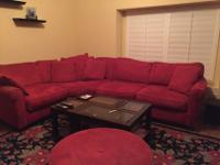 Large Red Sectional Couch in good condition. Has been