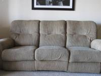 Tan couch and loveseat in good condition. Both have