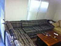 This is an L-shaped sectional couch in good condition.