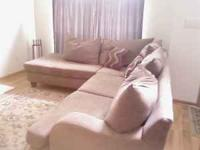 Khaki colored microfiber sectional in excellent