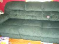 Hunter green couch with reclining ends. entire length