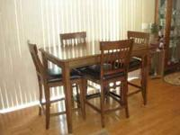 Only 1 yr old counter height / pub dining table w/ 4