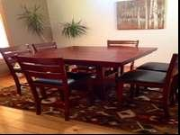 Good counter height table set including 6 stools.