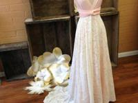 This is a stunning dress in fresh condition. It would