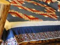 Beautiful, country style handmade quilt, constructed in