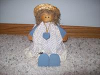 3 country Blue decor wooden dolls and 1 wooden rabbit.