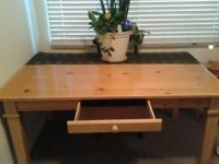 Solid pine table with a small drawer.  Excellent