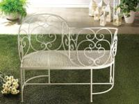 A sweet seat for two! This white metal bench features