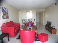Sixth floor 2 bedroom furnished condo overlooking the