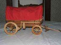 THIS IS A HAND MADE COVERED WAGON. IT IS 21 INCHES LONG