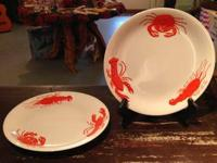 Below are some crab and lobster ornamental plates, come