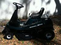 This is a 2002 Craftsman riding mower with the deck but