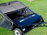This is a HEAVY DUTY Craftsman 32 inch lawnsweeper for