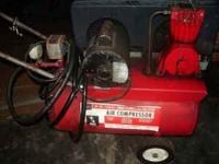 Small Craftsman Sears air compressor. Works great.