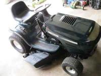 For sale is a craftsman lawn tractor. It runs, drives