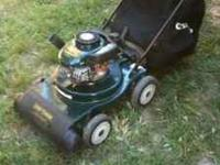 Craftsman lawn vacuum with wood chipper. Has a 4.5 hp