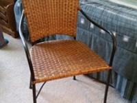 Rod iron/wicker chairs. Could be used as inside dining