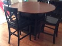 Counter height Crate and Barrel dining table with four