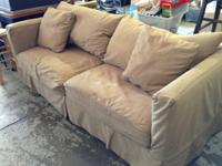 The sofa has a custom made slip cover on it that is
