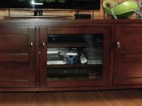 Dark mahogany stained wood media center purchased from