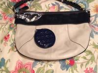 Cream and navy blue coach purse with change purse.
