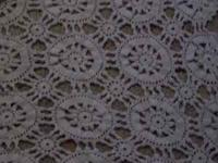 This cream colored crochet table cloth measures 72