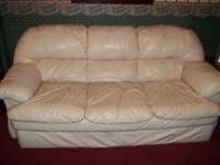 Cream Leather couch and love seat from John V Schultz.