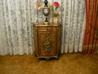 A beautiful small credenza hand carved in Italy rarely