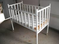 "75 year old hand crafted crib. 40"" long by 22"" wide"