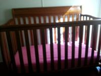 Crib used for 1  1/2 years. Has a few scratches At