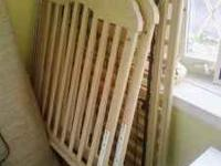 selling crib and changing table with pad and two