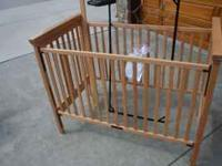 Good condition crib and changing table set in light