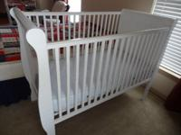 Like new white baby crib for sale. Includes mattress