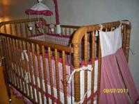Honey color, soild wood Jenny Lind crib, complete with